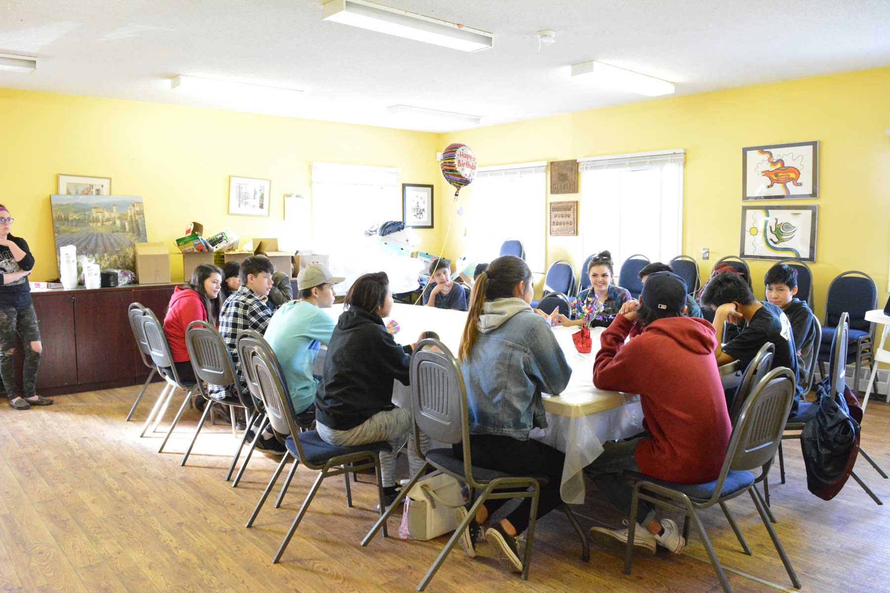 Youth from the ASP program celebrate their instructor Rene's birthday