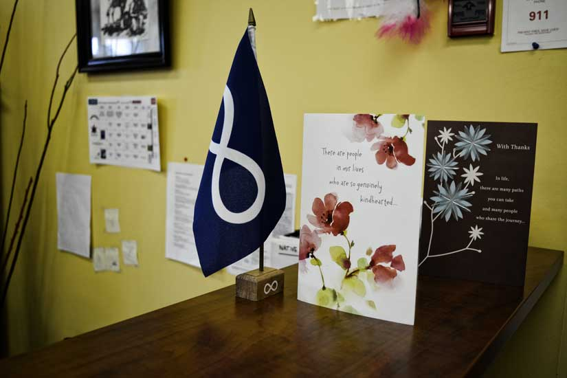 Metis Nation flag beside cards with quotes of inspiration