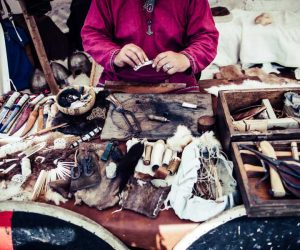 A Native handcrafting art on a workbench